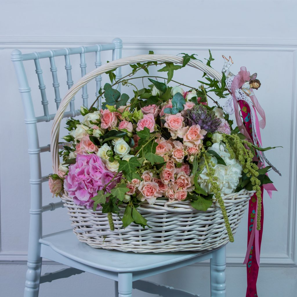 big basket mixed flowers standing white chair