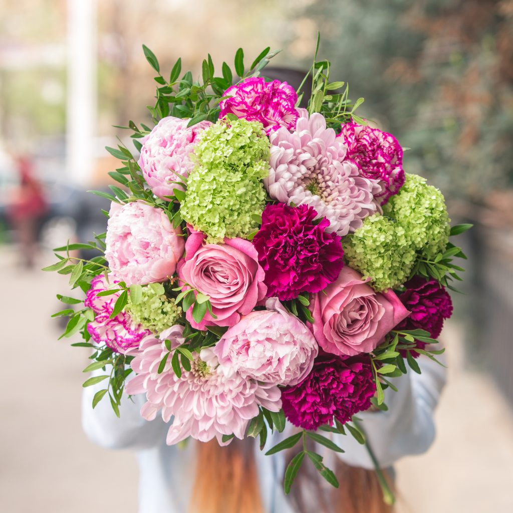 elegant bouquet pink purple flowers with decorative green leaves