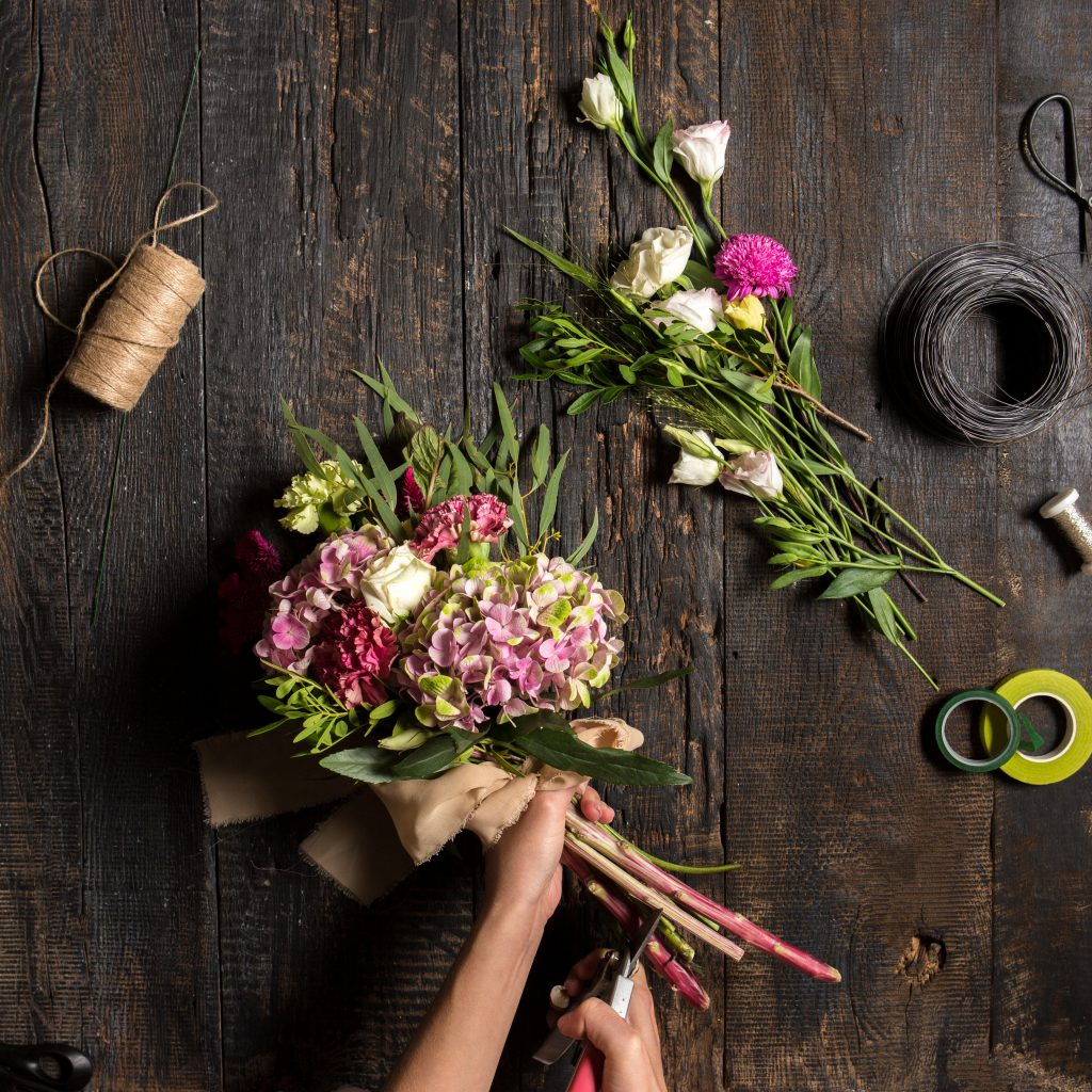 florist desktop with working tools ribbons